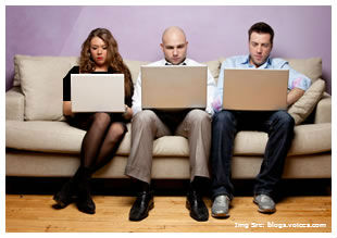 three-people-sitting-with-laptops